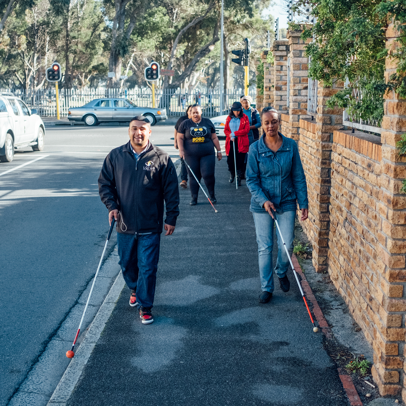 a group using canes to walk