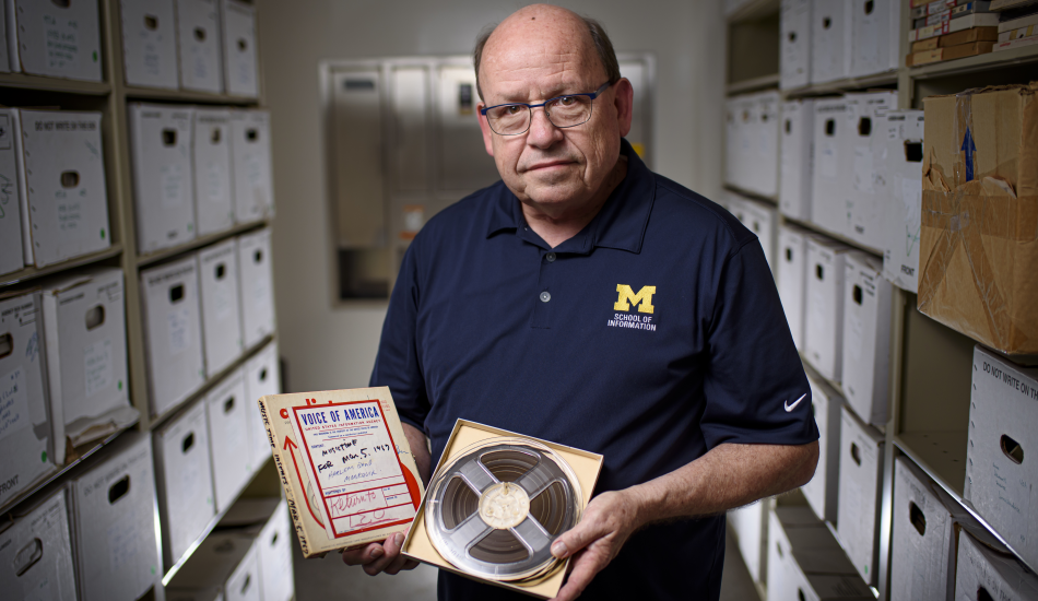 Paul Conway holding discs from the archives.