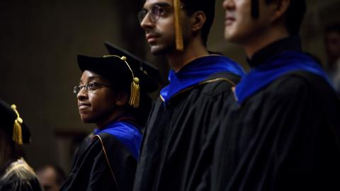 students in graduation regalia