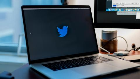 Photo of a laptop displaying the Twitter logo